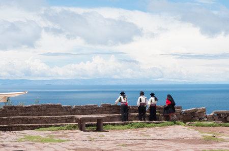 treck: TAQUILE, PERU - MARCH 20, 2015:Men in  traditional clothes at Taquile Island at lake Titicaca in Peru Editorial