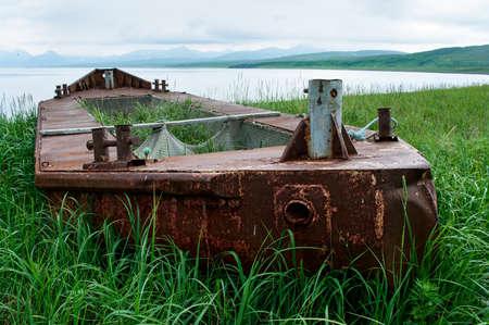 aground: Abandoned boat run aground at island Paramushir, Russia