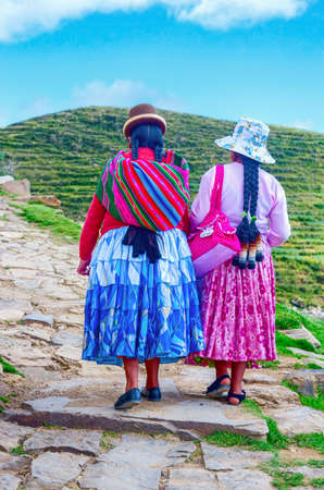 bolivian: Island of the Sun, Bolivia-March 22, 2015: Bolivian  women in traditional clothes on the street . Editorial