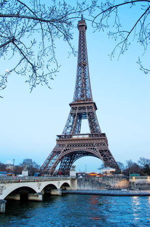 Eiffel Tower: Paris, France - March 2, 2015: The Eiffel Tower is one of the worlds most famous landmark in Paris, France. Editorial