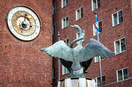 oslo: OSLO - SEPT 20:  clock of the Oslo City Hall building Sept 20, 2014 in Oslo, Norway Stock Photo