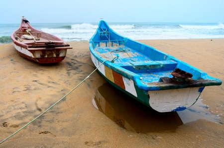 mamallapuram: Fishing boats beached along the coast  in Mamallapuram, Tamil Nadu, India