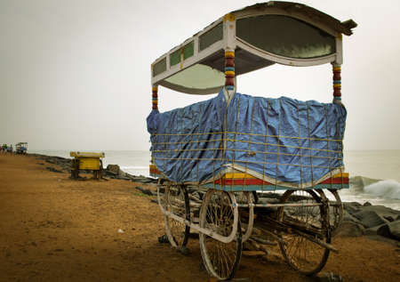 south india: Mobile stalls along sandy beach in Pondicherry, South India.