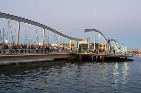 rambla: BARCELONA, SPAIN - JULY 10, 2014: Marina Port Vell and the Rambla del Mar at dusk in Barcelona, Catalonia, Spain on July 10, 2014. Editorial