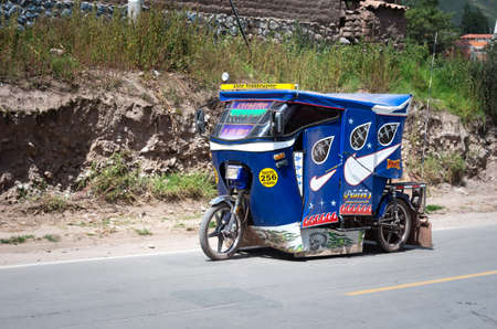 auto rickshaw: URUBAMBA, PERU - MARCH 10: Auto rickshaw drives down the street in Urubamba, Peru on March 10, 2015