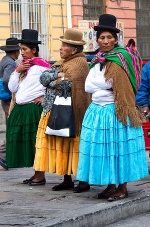 bolivian: La Paz, Bolivia-March 24, 2015: Bolivian women in traditional clothes on the street La Paz.