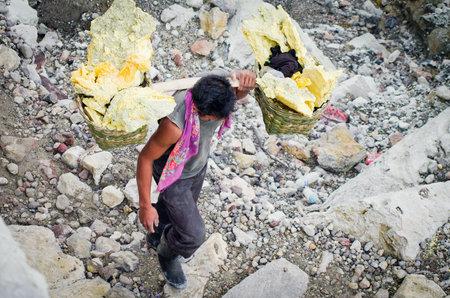 sulphuric acid: IJEN VOLCANO, INDONESIA - JAN 10: Extracting sulphur inside Kawah Ijen crater, Indonesia on Jan 10, 2011