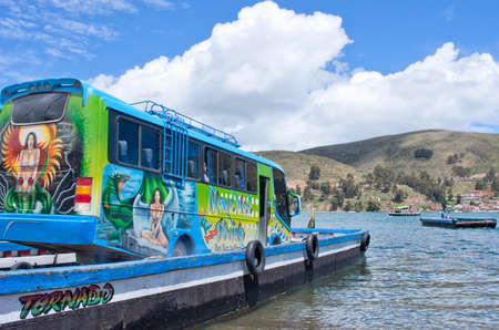house float on water: TITICACA LAKE, BOLIVIA - MARCH 23, 2015: Ferry service on lake Titicaca between the towns of San Pedro de Tiquina and San Pablo de Tiquina.