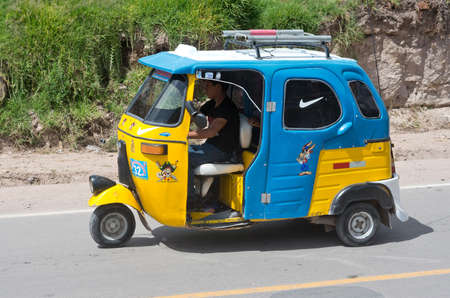 auto rickshaw: URUBAMBA, PERU - MARCH 10: Auto rickshaw drives down the street in Urubamba, Peru on March 10, 2015