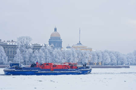 outpost: ST. PETERSBURG, RUSSIA - JAN 17, 2016: Ice-class tugboat Nevskaya Zastava (Neva Outpost) on Neva river. In spite of icebreaker functions it can put out fires and take part in rescue operations.
