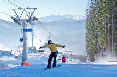 ukranian: BUKOVEL, UKRAINE - DEC 31, 2015: Skiers and snowboarders in Bukovel. Bukovel is the most popular  Ukranian mountain resort. Editorial