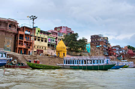 varanasi: VARANASI, INDIA-01 OCT: View of Ganges river with the boats and city 01 Oct, 2013 in Varanasi. Varanasi is the spiritual capital of India.
