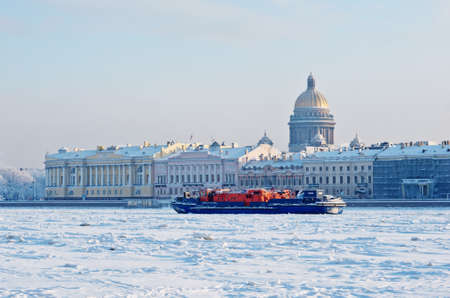 spite: ST. PETERSBURG, RUSSIA - JAN 17, 2016: Ice-class tugboat Nevskaya Zastava (Neva Outpost) on Neva river. In spite of icebreaker functions it can put out fires and take part in rescue operations.