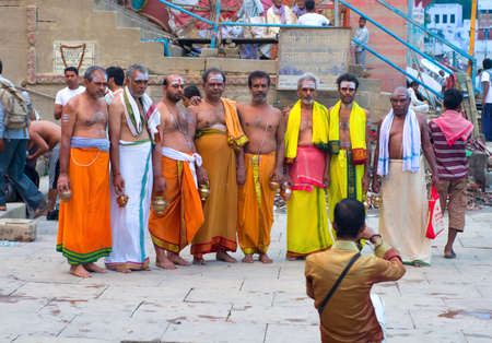 benares: VARANASI, INDIA-01 OCT: unidentified men posing for the photographer 01 Oct, 2013 in Varanasi. Varanasi is the spiritual capital of India.