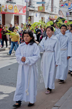 christianity palm sunday: SUCRE, BOLIVIA - MARCH 29: Participants of the Catholic feast of Palm Sunday on the street on March 29, 2015 in Sucre, Bolivia Editorial