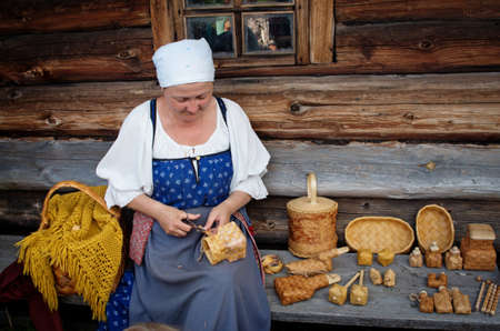 birchbark: KIZHI, RUSSIA -  AUG 07, 2015: Women in traditional russian costume   in Historico-architectural museum Kizhi on Kizhi island, Karelia, Russia. Editorial