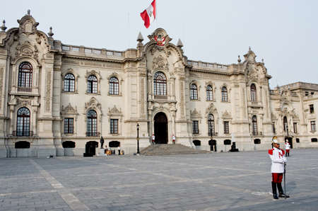 pizarro: Lima, Peru - March 6, 2015: The Government Palace at Plaza de Armas with guards in Lima, Peru Editorial