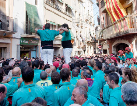 fiesta popular: TORREDEMBARRA, SPAIN - JULY 13, 2014: Castells Performance   in Torredembarra, Catalonia, Spain. A Castell is a  Human Tower  built traditionally in Catalonia.