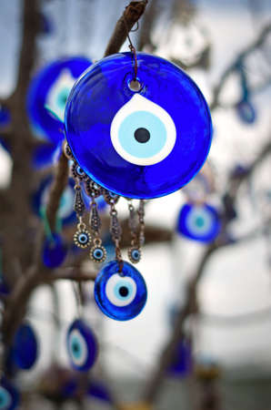eye protectors: A nazar, charms to ward off the evil eye , on the branches of a tree in Cappadocia, Turkey