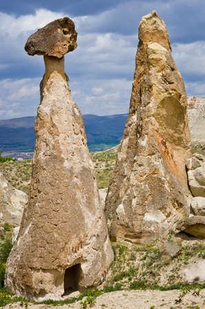 phallic: Rock-mushrooms, spectacular landscape of fairy chimneys carved in volcanic tuff by erosion. Cappadocia, Turkey