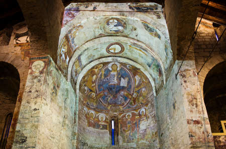 TAULL, SPAIN - JULY 18, 2014: Church Sant Climent de Taull. The hypothetical reconstruction of the entire ensemble fresco paintings (projection show).