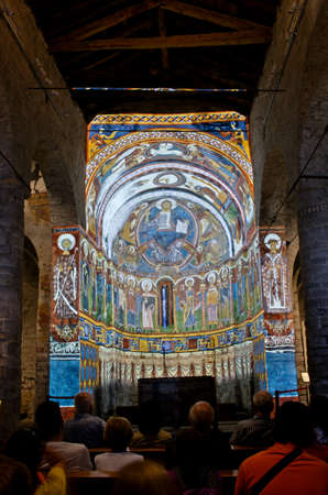 pantocrator: TAULL, SPAIN - JULY 18, 2014: Church Sant Climent de Taull. The hypothetical reconstruction of the entire ensemble fresco paintings (projection show).