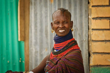 NORTHERN KENYA-JAN 07:Turkana woman in traditional clothes Jan 7, 2013. The Turkana people are the second largest of the pastoral people of Kenya.They occupy an area of about 67,000 square kilometers Editorial