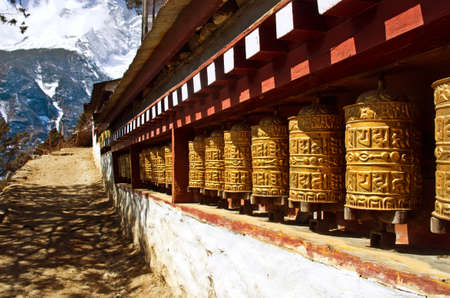 bazar: Buddhist wheels in Namche Bazar, Everest region, Nepal Stock Photo
