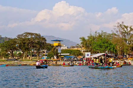 phewa: POKHARA, NEPAL - MARCH 30: Unidentified tourists do boating on Fewa (Phewa) lake on March 30, 2014 in Pokhara, Nepal. Pokhara is a popular tourist destination in Nepal.