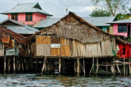 Wooden houses on piles on lake Sentani, on New Guinea Island, Indonesia. Stock Photo