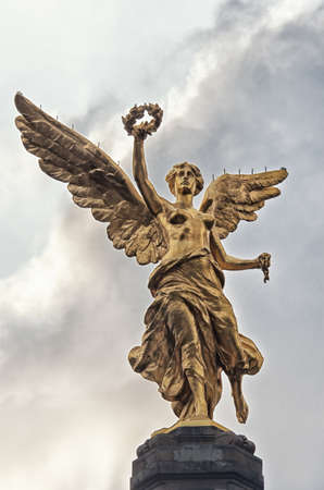 angel de la independencia: The Angel of Independence against the sky in Mexico City, Mexico.