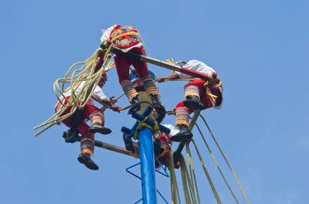 Mexico City, Mexico - November 15, 2016: Danza de los Voladores (Dance of the Flyers)- flying men performing the voladores ritual in Chapultepec in Mexico City Stock Photo
