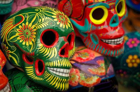 Decorated colorful skulls, ceramics death symbol at market, day of dead, Mexico Editorial