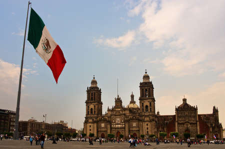 Mexico City, Mexico - November 14, 2016: Big Mexican Flag on Zocalo near Cathedral - Mexico City, Mexico