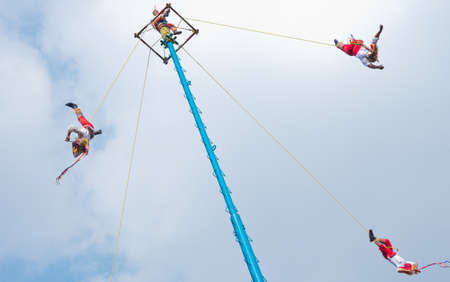 Mexico City, Mexico - November 15, 2016: Danza de los Voladores (Dance of the Flyers)- flying men performing the voladores ritual in Chapultepec in Mexico City Editorial