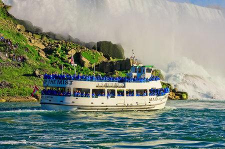 Niagara Falls, USA - September 24, 2016: Ferry Maid of the Mist in the Niagara River against American waterfall. Niagara Falls. Editorial