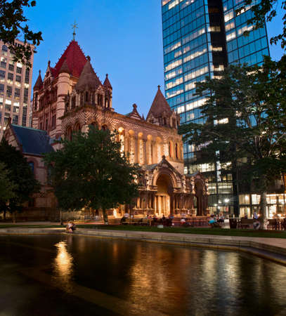 Boston, MA, USA - August 26, 2016: View of Trinity Church and the John Hancock Building at night, at Copley Square in Boston