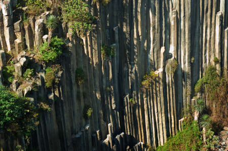 Basaltic Prisms of Santa Maria Regla. Tall columns of basalt rock in canyon, Huasca de Ocampo, Mexico