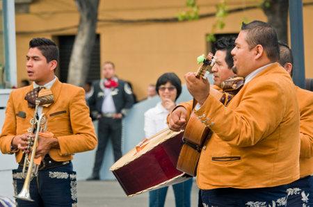 traje mexicano: Mexico City - December 03, 2016 : Mariachi band play mexican music at Garibaldi Square in Mexico City, Mexico.