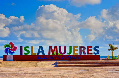 Isla Mujeres, Mexico - October 18, 2016 : Colorful inscription Isla Mujeres (Island of the Women) on caribbean sea coast, Mexico
