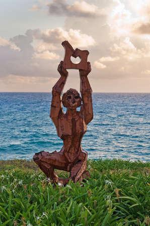 Modern sculpture on Caribbean sea coast, Isla Mujeres, Mexico
