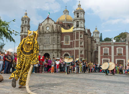 Mexico City, Mexico - December 10, 2016: Festival of the Virgin of Guadalupe with a mass ceremony in her honor on square of Basilica of Our Lady of Guadalupe Editorial