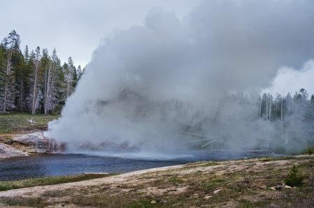 Riverside Geyser eruption at Upper Geyser Basin in Yellowstone National Park, USA