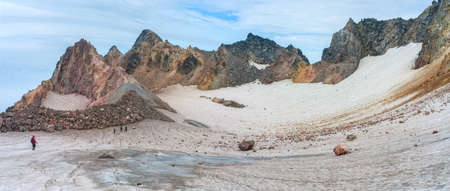Trekker at crater of Fuss Peak Volcano, Paramushir Island, Kuril Islands, Russia