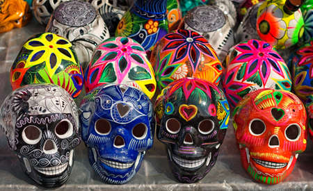 Decorated colorful skulls, ceramics death symbol at market, day of dead, Mexico Stock Photo