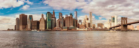 Cityscape and Brooklyn Bridge in New York. Panoramic view