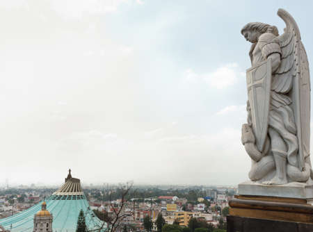 Mexico City, Mexico - November 30, 2016: Statue of the Archangel Michael stands on top of Tepeyac Hill near the Basilica of Guadalupe in Mexico City