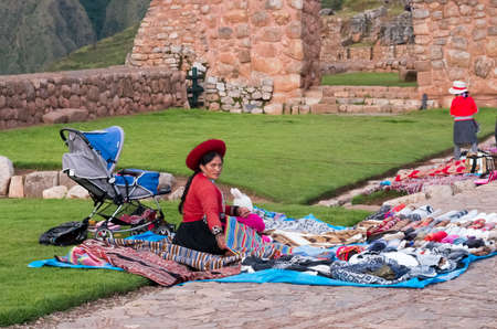 Chinchero, Peru - March 9, 2015: Peruvian women dressed in traditional clothes at local market