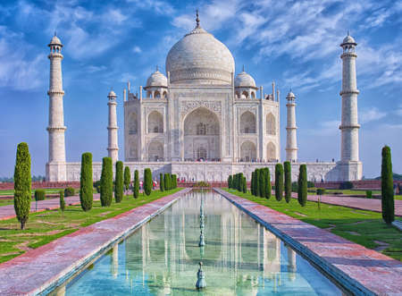 Taj Mahal at morning light with reflection in water in Agra, Uttar Pradesh, India