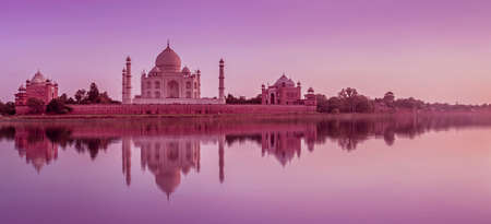 Panoramic view of Taj Mahal during sunset reflected in the Yamuna river, in Agra , Uttar Pradesh, India